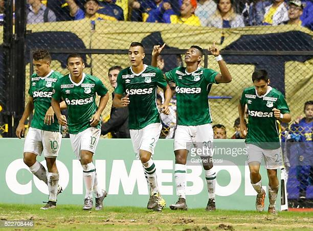 Mateo Casierra of Deportivo Cali celebrates with teammates after scoring the first goal of his team during a match between Boca Juniors and Deportivo...