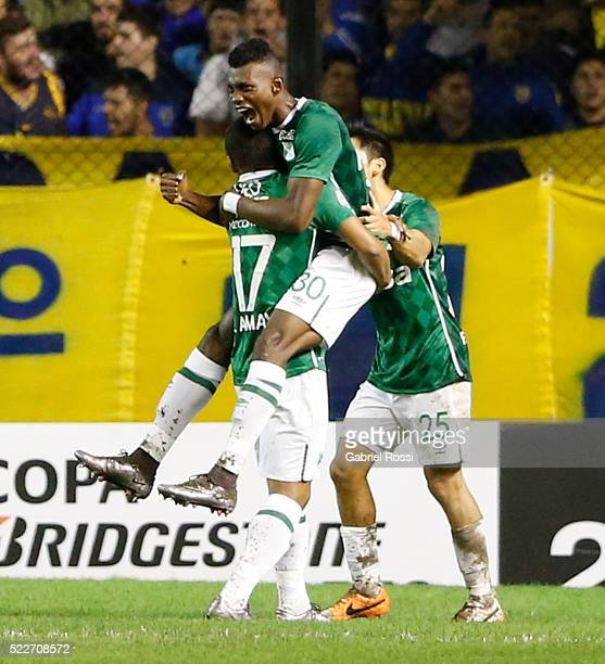 Mateo Casierra of Deportivo Cali celebrates with teammates after scoring the second goal of his team during a match between Boca Juniors and...