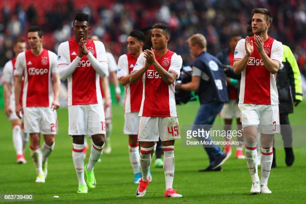 Mateo Cassierra Justin Kluivert and Joel Veltman of Ajax celebrate victory after the Dutch Eredivisie match between Ajax Amsterdam and Feyenoord at...