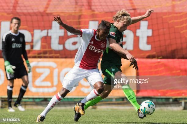 Mateo Cassierra of Ajax Jesper Verlaat of SV Werder Bremen during the friendly match between Ajax Amsterdam and SV Werder Bremen at Lindenstadion on...