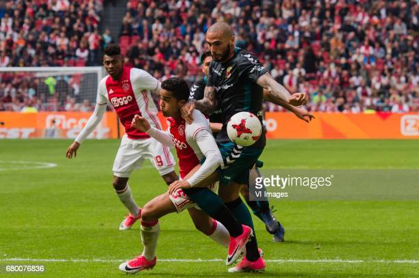 Mateo Cassierra of Ajax Justin Kluivert of Ajax Joey Suk of Go Ahead Eaglesduring the Dutch Eredivisie match between Ajax Amsterdam and Go Ahead...