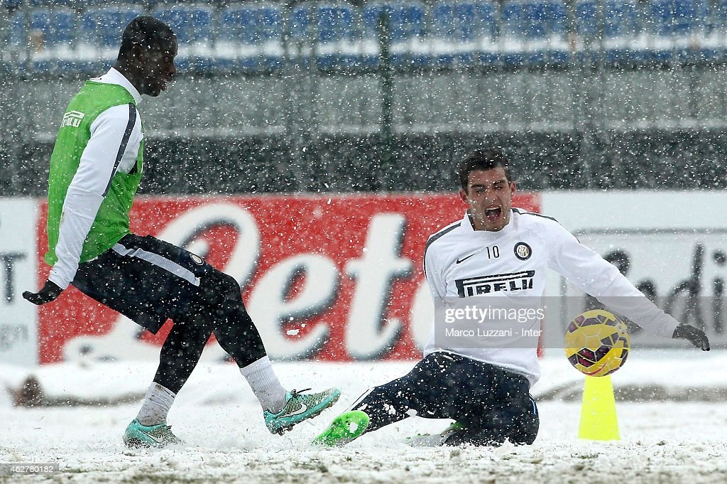 Mateo Kovacic (R) competes with Isaak Donkor (L) during an FC Internazionale training session at the club's training ground on February 5, 2015 in Appiano Gentile Como, Italy.