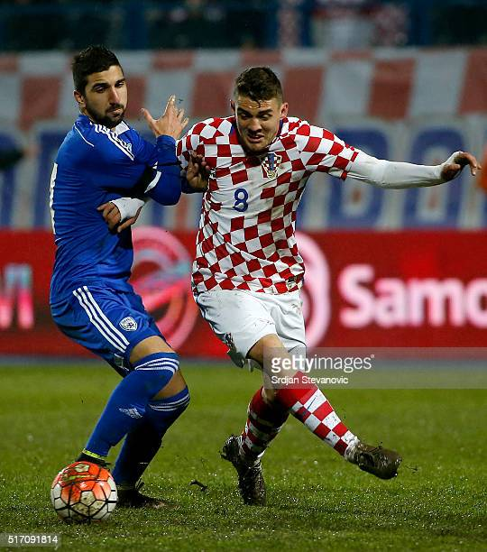 Mateo Kovacic of Croatia in action against Muanes Dabbur of Israel during the International Friendly match between Croatia and Israel at stadium...