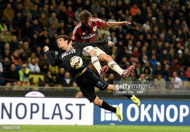Mateo Kovacic of FC Internazionale and Andrea Poli of AC Milan compete for the ball during the Serie A match between FC Internazionale Milano and AC...