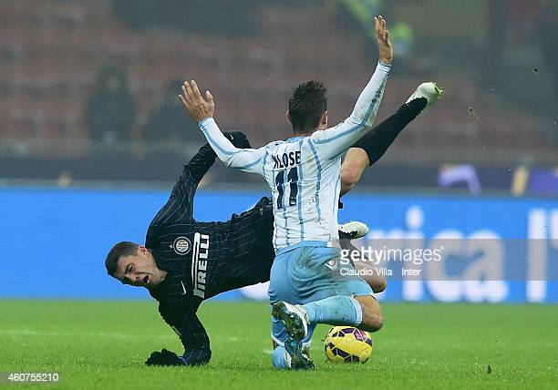 Mateo Kovacic of FC Internazionale and Miroslav Klose of SS Lazio compete for the ball during the Serie A match betweeen FC Internazionale Milano and...