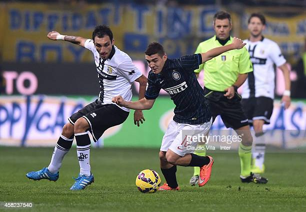 Mateo Kovacic of FC Internazionale Milano and Francesco Lodi of Parma FC compete for the ball during the Serie A match between Parma FC and FC...