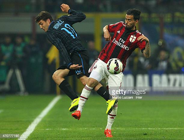 Mateo Kovacic of FC Internazionale Milano competes for the ball with Suso of AC Milan during the Serie A match between FC Internazionale Milano and...