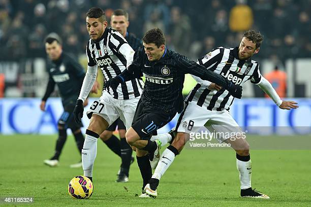 Mateo Kovacic of FC Internazionale Milano is challenged by Claudio Marchisio and Roberto Pereyra of Juventus FC during the Serie A match between...