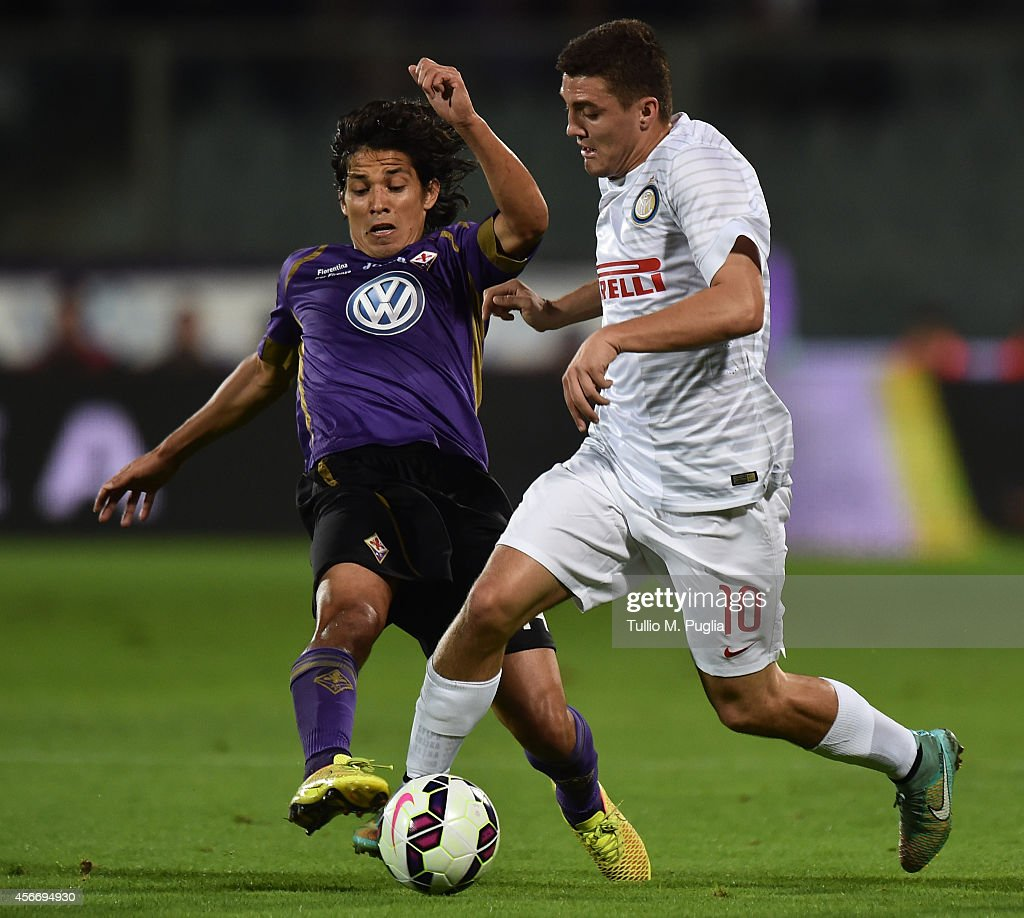 Mateo Kovacic of Inter and Matias Fernandez of Fiorentina compete for the ball during the Serie A match between ACF Fiorentina and FC Internazionale...
