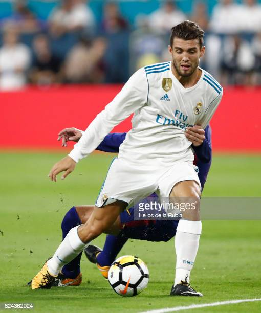 Mateo Kovacic of Real Madrid and Gerard Pique of Barcelona FC compete for the ball during the International Champions Cup 2017 match between Real...