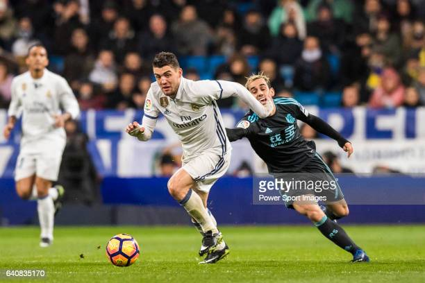 Mateo Kovacic of Real Madrid battles for the ball with Juanmi Jimenez of Real Sociedad during their La Liga match between Real Madrid and Real...