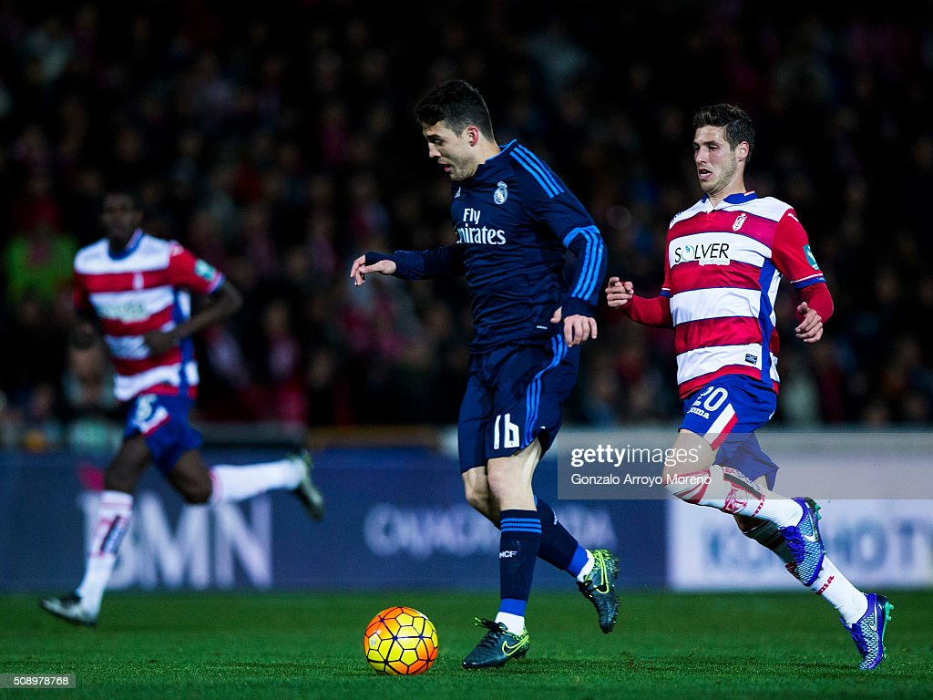 Mateo Kovacic (L) of Real Madrid CF competes for the ball with Ruben Perez (R) of Granada CF during the La Liga match between Granada CF and Real Madrid CF at Estadio Nuevo Los Carmenes on February 7, 2016 in Granada, Spain.
