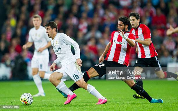 Mateo Kovacic of Real Madrid CF duels for the ball with Raul Garcia of Athletic Club Bilbao during the La Liga match between Athletic Club Bilbao and...
