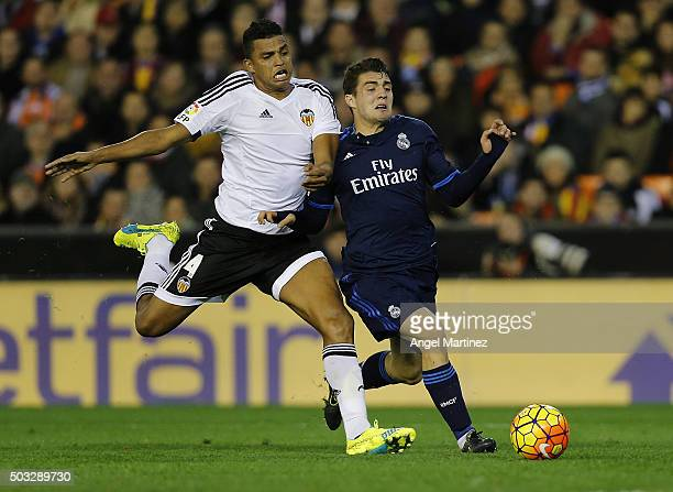 Mateo Kovacic of Real Madrid competes for the ball with Aderlan Santos of Valencia CF during the La Liga match between Valencia CF and Real Madrid CF...