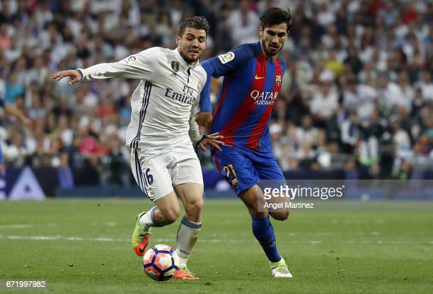 Mateo Kovacic of Real Madrid competes for the ball with Andre Gomes of FC Barcelona during the La Liga match between Real Madrid and FC Barcelona at...