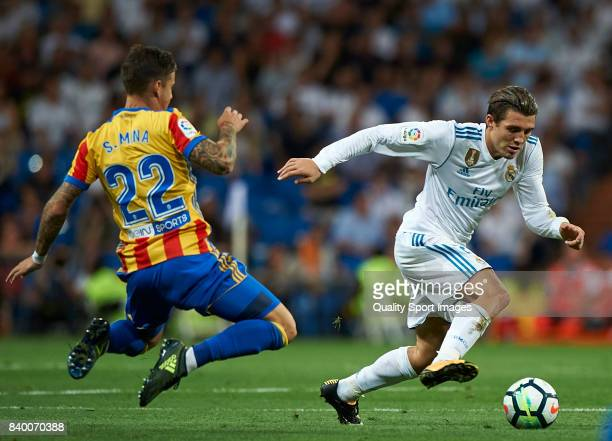 Mateo Kovacic of Real Madrid competes for the ball with Santi Mina of Valencia during the La Liga match between Real Madrid and Valencia at Estadio...