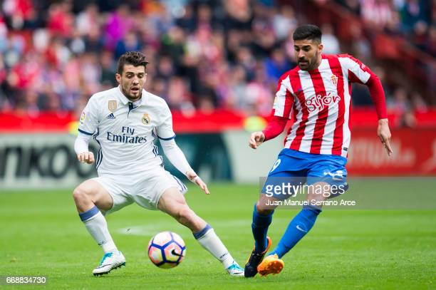 Mateo Kovacic of Real Madrid duels for the ball with Carlos Carmona of Real Sporting de Gijon during the La Liga match between Real Sporting de Gijon...