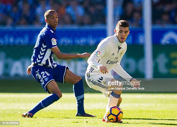 Mateo Kovacic of Real Madrid duels for the ball with Deyverson Brum of Deportivo Alaves during the La Liga match between Deportivo Alaves and Real...