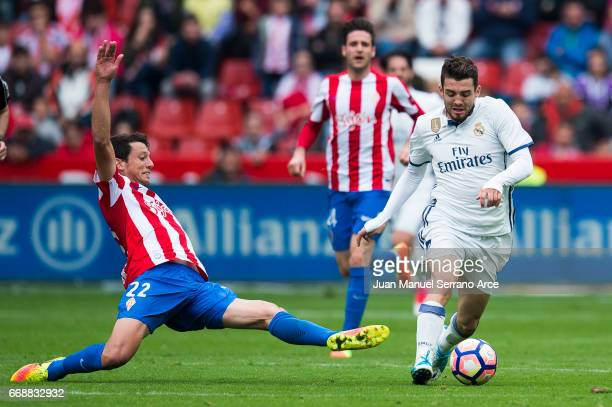Mateo Kovacic of Real Madrid duels for the ball with Mikel Vesga of Real Sporting de Gijon during the La Liga match between Real Sporting de Gijon...