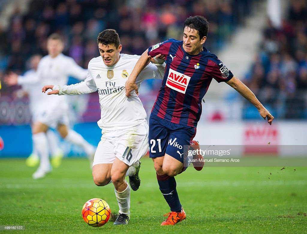 Mateo Kovacic of Real Madrid duels for the ball with Saul Berjon of SD Eibar during the La Liga match between SD Eibar and Real Madrid at Ipurua Municipal Stadium on November 29, 2015 in Eibar, Spain.