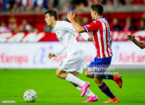 Mateo Kovacic of Real Madrid duels for the ball with Sergio Alvarez of Real Sporting de Gijon during the La Liga match between Sporting Gijon and...
