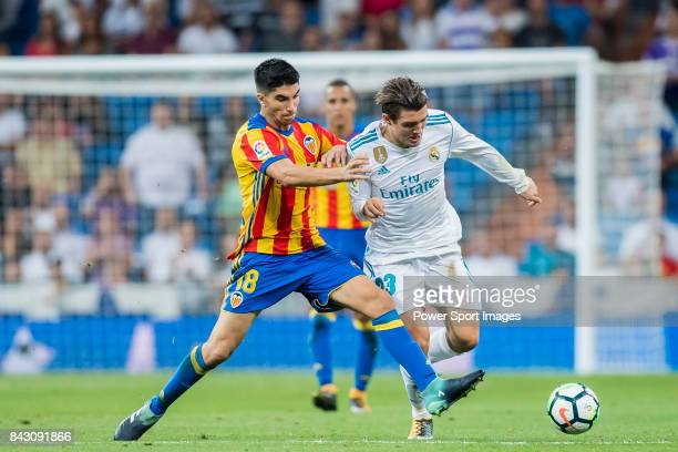 Mateo Kovacic of Real Madrid fights for the ball with Carlos Soler Barragan of Valencia CF during their La Liga 201718 match between Real Madrid and...