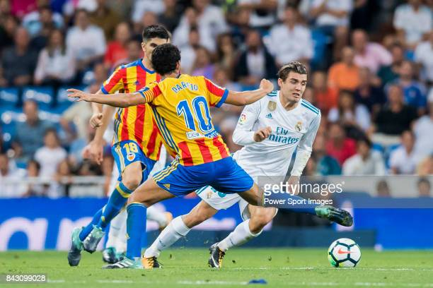 Mateo Kovacic of Real Madrid fights for the ball with Daniel Parejo Munoz of Valencia CF during their La Liga 201718 match between Real Madrid and...
