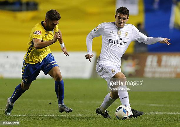Mateo Kovacic of Real Madrid is chased by Lolo Pla of Cadiz during the Copa del Rey round of 32 first leg match between Cadiz and Real Madrid CF at...