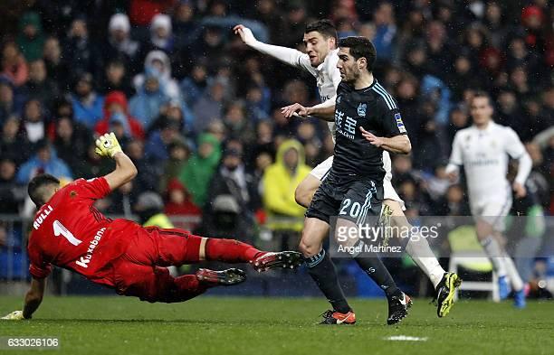 Mateo Kovacic of Real Madrid scores the opening goal past Geromino Rulli and Joseba Zaldua of Real Sociedad during the La Liga match between Real...