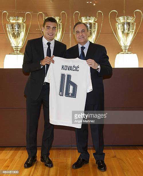 Mateo Kovacic poses with president Florentino Perez during his official unveiling as a new Real Madrid player at Estadio Santiago Bernabeu on August...