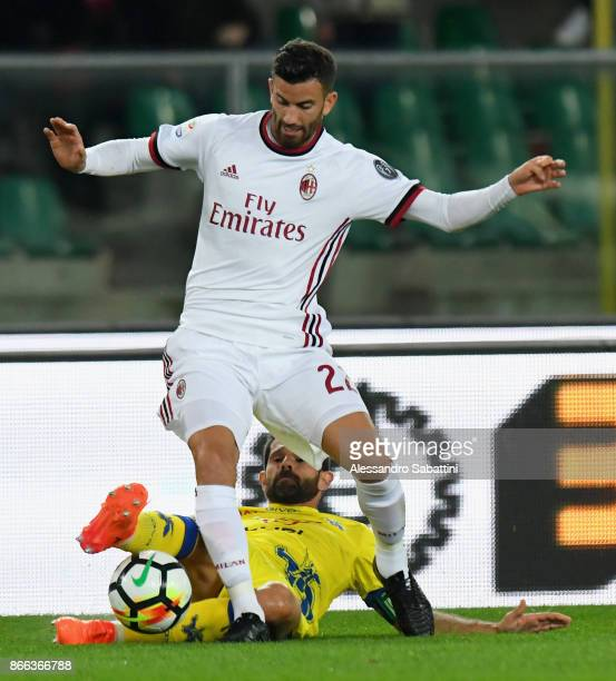 Mateo Musacchio of AC Milan competes for the ball whit Sergio Pellissier AC Chievo Verona during the Serie A match between AC Chievo Verona and AC...