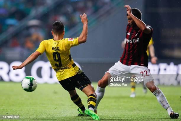 Mateo Musacchio of AC Milan defends Emre Mor of Borussia Dortmund at University Town Sports Centre Stadium during the 2017 International Champions...