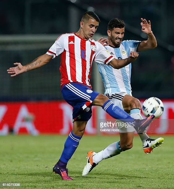Mateo Musacchio of Argentina fights for the ball with Derlis Gonzalez of Paraguay during a match between Argentina and Paraguay as part of FIFA 2018...