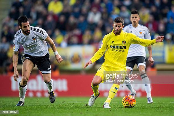 Mateo Musacchio of Villarreal CF being followed by Alvaro Negredo of Valencia CF during the Villarreal CF vs Valencia CF as part of the Liga BBVA...