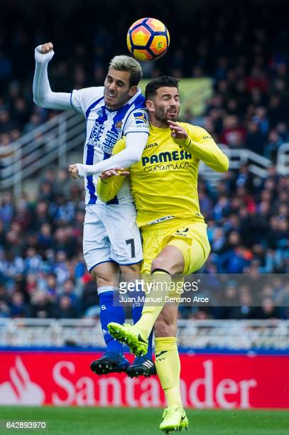 Mateo Musacchio of Villarreal CF duels for the ball with Juan Miguel Jimenez 'Juanmi' of Real Sociedad during the La Liga match between Real Sociedad...