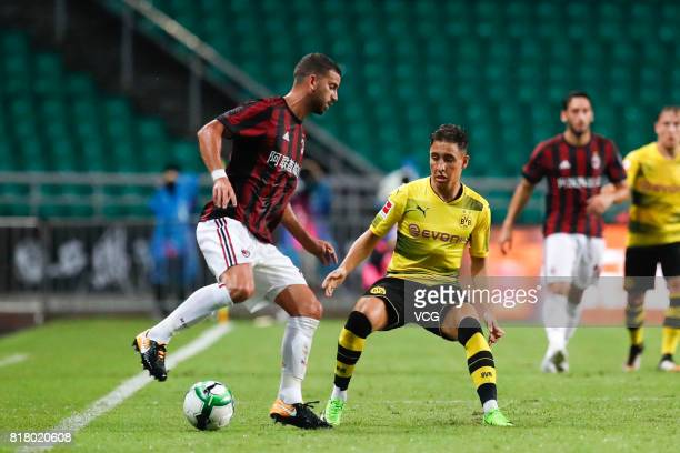 Mateo Pablo Musacchio of AC Milan and Emre Mor of Borussia Dortmund compete for the ball during the 2017 International Champions Cup China between AC...
