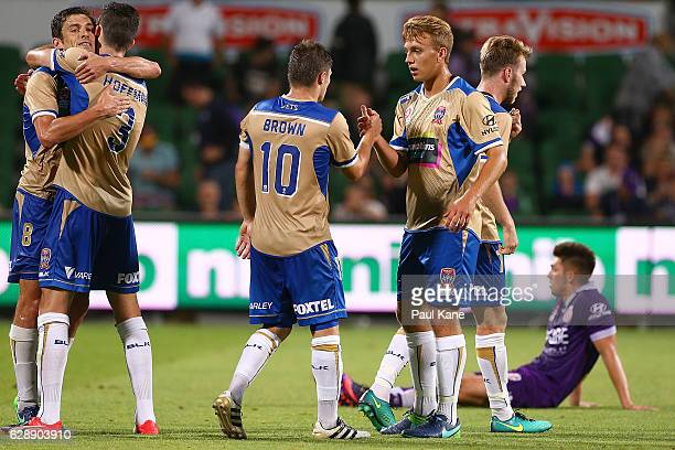 Mateo Poliak Jason Hoffman Wayne Brown and Kristian Brymora of the Jets celebrate winning the round 10 ALeague match between the Perth Glory and the...