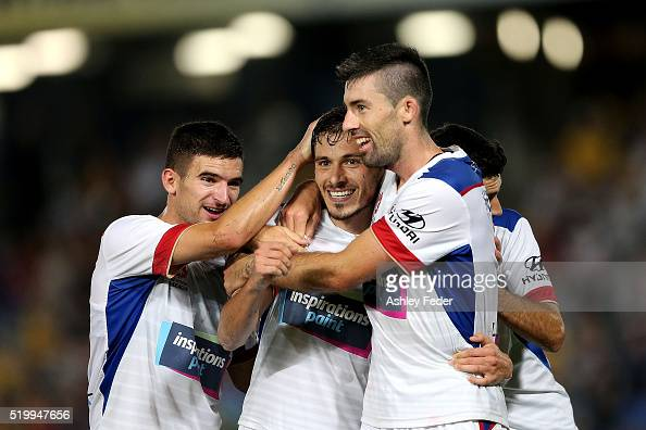 Mateo Poljak and Jason Hoffman of the Jets celebrate a goal during the round 27 ALeague match between the Central Coast Mariners and the Newcastle...