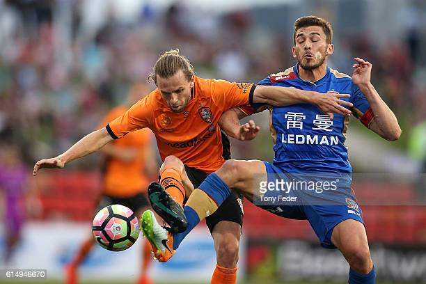 Mateo Poljak of the Jets and Brett Holman of the Roar contest the ball during the round two ALeague match between the Newcastle Jets and the Brisbane...