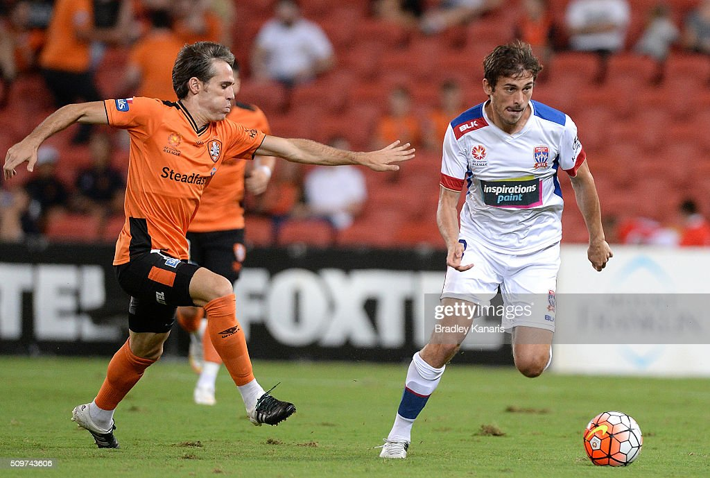 Mateo Poljak of the Jets attempts to breaks away from the defence of Corona of the Roar during the round 19 A-League match between the Brisbane Roar and the Newcastle Jets at Suncorp Stadium on February 12, 2016 in Brisbane, Australia.