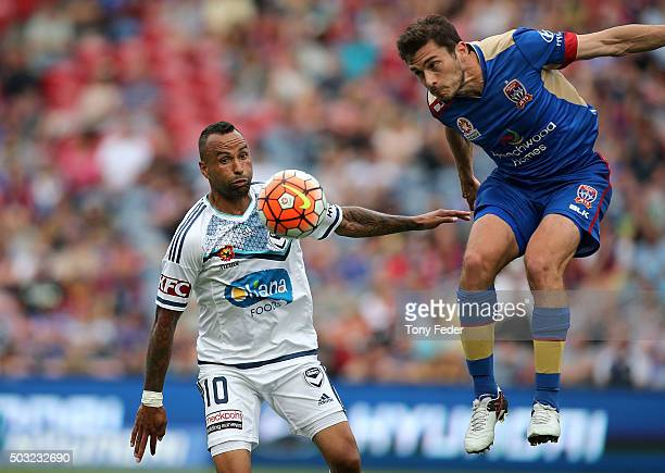 Mateo Poljak of the Jets contests the ball with Archie Thompson of the Victory during the round 13 ALeague match between the Newcastle Jets and...