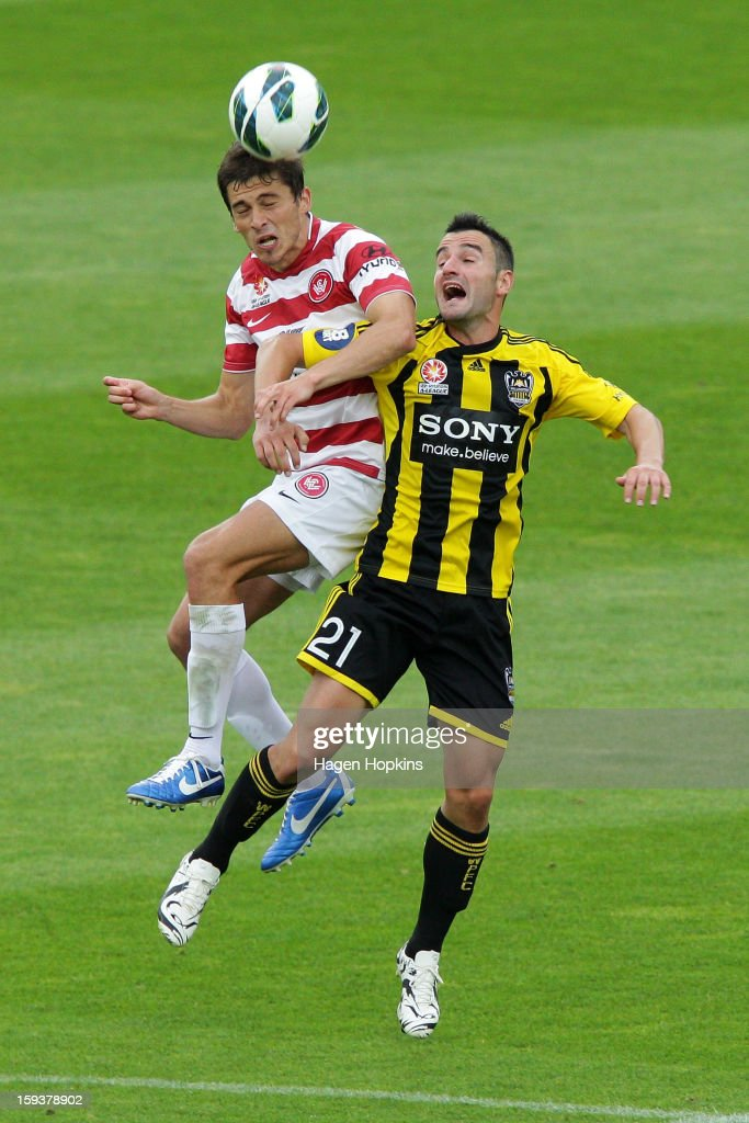 Mateo Poljak of the Wanderers and Dani Sanchez of the Phoenix challenge for a header during the round 16 A-League match between the Wellington Phoenix and the Western Sydney Wanderers at Westpac Stadium on January 13, 2013 in Wellington, New Zealand.