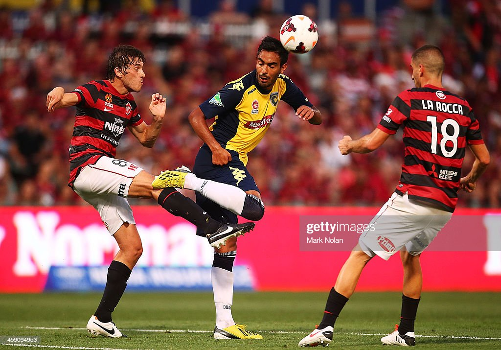 Mateo Poljak of the Wanderers and Marcos Flores of the Mariners contest possession during the round 11 A-League match between the Western Sydney Wanderers and the Central Coast Mariners at Parramatta Stadium on December 23, 2013 in Sydney, Australia.
