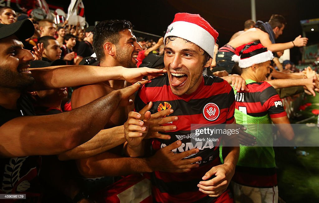 Mateo Poljak of the Wanderers celebrates with fans after winning the round 11 A-League match between the Western Sydney Wanderers and the Central Coast Mariners at Parramatta Stadium on December 23, 2013 in Sydney, Australia.