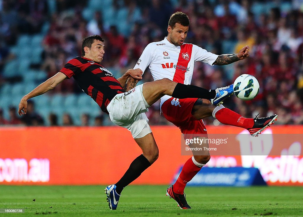 Mateo Poljak of the Wanderers competes with Nicholas Kalmar of the Heart during the round 18 A-League match between the Western Sydney Wanderers and the Melbourne Heart at Parramatta Stadium on January 26, 2013 in Sydney, Australia.