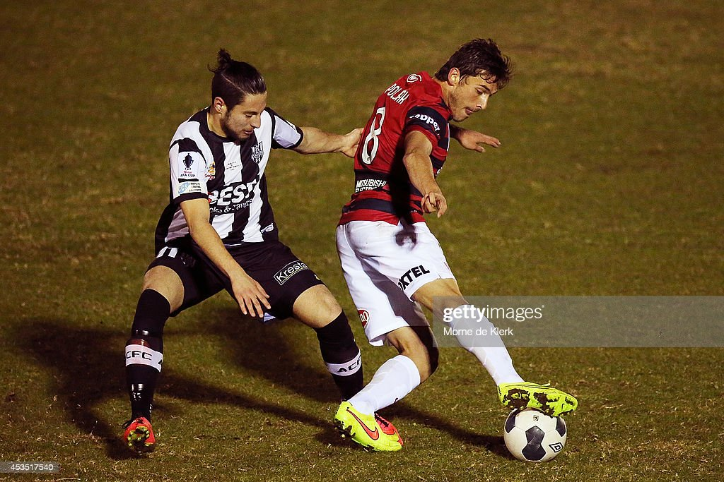 Mateo Poljak of Western Sydney wins the ball against Nicholas Bucco of Adelaide City during the FFA Cup match between Adelaide City and Western Sydney Wanderers at Marden Sports Complex on August 12, 2014 in Adelaide, Australia.