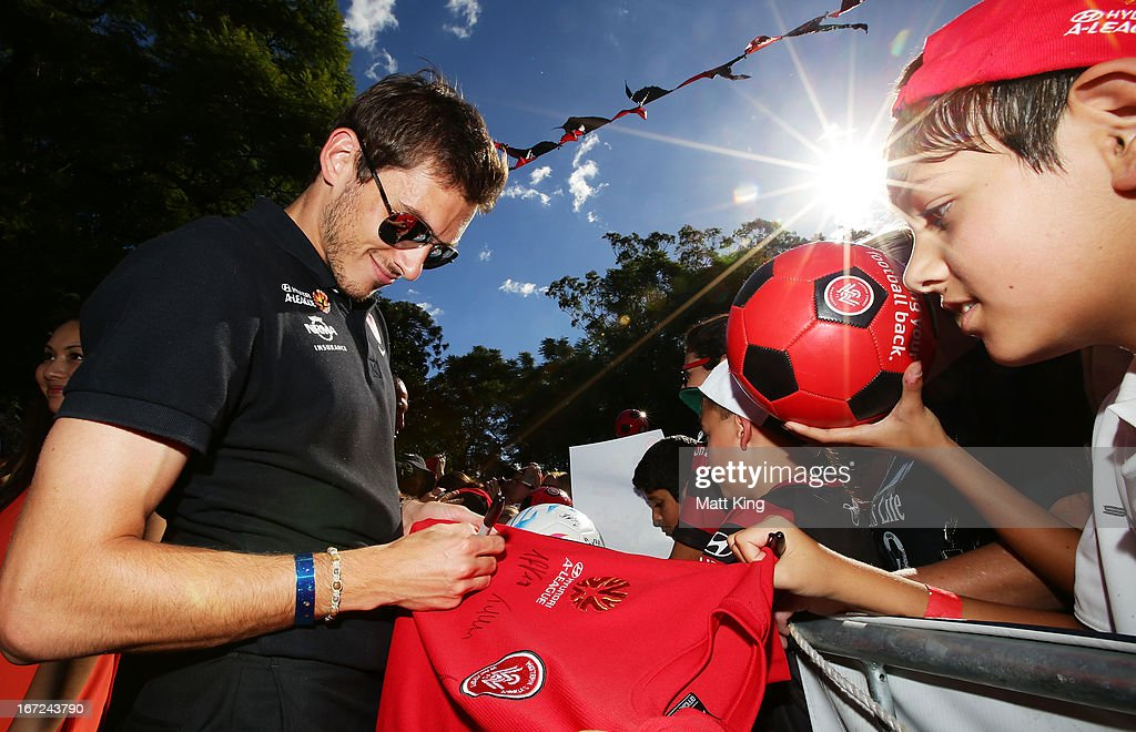 Mateo Poljak signs autographs for fans during a Western Sydney Wanderers A-League Civic Reception on April 23, 2013 in Parramatta, Australia.