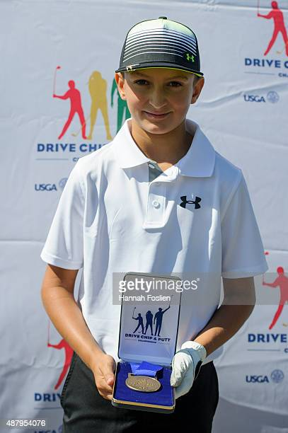 Mateo Rascon poses for a photo after winning first place in drive at a Regional Finals for 1011 year old boys at the Drive Chip and Putt competition...