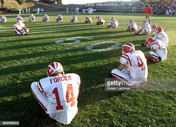 Mater Dei vs Mission Viejo at Mission Viejo High School The Mater Dei football team casts shadows across the field as they stretch before their game...
