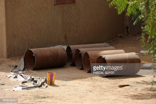 Material used to make a homemade bomb is pictured on February 13 2013 in a courtyard of an abandoned house in the centre of northern Mali's largest...
